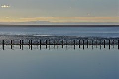 Across the bay (Nige H (Thanks for 15m views)) Tags: nature landscape seascape westonsupermare somerset england fence reflection beach lake