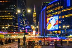 W33rd & 8th at Twilight (ericjmalave) Tags: empirestatebuilding nyc newyorkcity madisonsquaregarden 33rd 8th night fujix fujixt10 samtang12mm fujixf1855mm cartrails twilight longexposure sunset esb midtown
