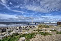 Beacon (Photos taken with Sony mirrorless cameras) Tags: newbrighton beach wirral merseyside lighthouse sand sky clouds blue sea people couple