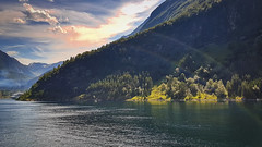 peaking around the corner (Geert E) Tags: landschap landscape scenery sunset fjord cruise nature boat ship