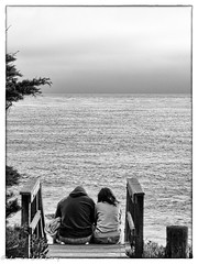 Reflective Couple (lorinleecary) Tags: ocean horizons steps cambria marineterrace overcast monochome blackandwhite centralcoastcalifornia couples