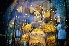Like a golden goddess (Eric Flexyourhead) Tags: vancouver canada britishcolumbia bc downtown granvillestreet city urban detail fragment holtrenfrew shop store window display windowdressing mannequin fashion fashionable style stylish clothes clothing red glass reflections sonyalphaa7 zeisssonnartfe35mmf28za zeiss 35mmf28