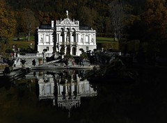 Linderhof reflections (SM Tham) Tags: europe bavaria linderhofpalace rococostyle architecture building statelyhome palace kingludwigii statues statuary people autumn fall mountain mountainside trees pond water reflections gardens gardenstosee germany historical