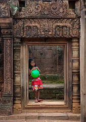 Cambodian little girl with a green balloon in Banteay Srei temple gate, Siem Reap Province, Angkor, Cambodia (Eric Lafforgue) Tags: ancientcivilisation angkor angkorwat apsara architecture artscultureandentertainment asia ball banteaysrei buddhism cambodia child childhood children colourimage cultures day famousplace girl girls history indochina khmer monument oldruin onegirlonly oneperson people photography placeofworship religion siemreap spirituality temple thepast tourism toy traditionallycambodian travel traveldestinations unescoworldheritagesite vertical wat yasodharapura camboimg9887 siemreapprovince