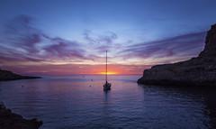 Xlendi Bay Sunset (CraDorPhoto) Tags: canon6d sunset boat yacht sky clouds colour cliffs bay water sea mediterranean landscape xlendi gozo malta