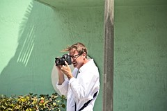 White Shirted Photographer (LarryJay99 ) Tags: pridefest2018 2018 lakeworth florida festival parade men male man guy guys dude dudes canondslr canoncanon handsome handsomenen hairyarms streets streetstuff urbanimpressions urbannomads urban container script potted plant street furniture los olas ft lauderdale urbanites people