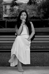 The Secret (TheseusPhoto) Tags: pretty girl female woman model modeling beautiful portrait portraiture pose face fashion dress elegant artistic bnw blackandwhite monochrome bench secret sitting