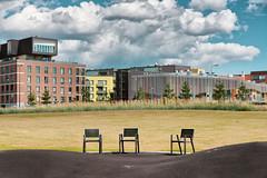 Kalasatama Park (1) (pni) Tags: this chair pavement grass park building sky cloud kalasatama fiskehamn helsinki helsingfors finland suomi pekkanikrus skrubu pni