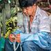 Rosary Vendor Praying