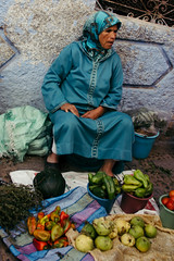 vegetable sale (rick.onorato) Tags: morocco desert arab berber north africa blue city woman