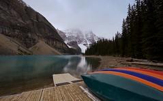 Classic Canadiana (chris.ph) Tags: morainelake autumn canoes alberta mountains snow lake canon6d ef1635mmf4lisusm alwayscarryhandwarmers