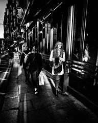 20/20 (Kieron Ellis) Tags: woman women people walking windows reflection shadow road bag pavement candid street blackandwhite blackwhite monochrome
