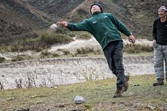 Men playing dego (Traditional Bhutanese game) - Chozo - Lunana Gewog - Gasa District - Snowman Trek - Bhutan (PascalBo) Tags: nikon d500 asie asia southasia asiedusud drukyul drukgyalkhap bhutan bhoutan འབྲུག་ཡུལ། འབྲུག་རྒྱལ་ཁབ་ snowman trek trekking hike hiking lunana gasa himalaya himalayas jigmedorjinationalpark dego game jeu man homme outdoor outdoors pascalboegli
