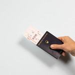 Passport with plane tickets thumbnail