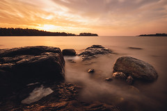 First Sunrise (Bunaro) Tags: uutela vuosaari helsinki finland suomi visitfinland myhelsinki sunset nature landscape waterscape sunrise longexposure smooth water sea long clouds rising sun good morning