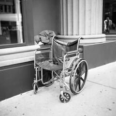 american-healthcare (kaumpphoto) Tags: rolleiflex tlr 120 bw black white street urban city minneapolis wheelchair health sidewalk homeless wheel seat chrome cement america healthcare