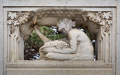 A sculpture depicting a woman gathering fruit on the 1915 Thomas Lowry memorial at Smith Triangle Park in Minneapolis, Minnesota, USA - The monument was designed by Austrian-born sculptor Karl Bitter. (thstrand) Tags: 20thcentury adult adultfemale agegroups american americans art arts artwork carvedstone carving culturalheritage decorativeart femalefigure gatheringfruit historic history karlbitter limestone lowryhill mn memorial memorials midwest midwestern minneapolis minnesota monument monuments nobody outdoors outside parks publicart sculpture smithtrianglepark thomaslowry thomaslowrymemorial twincities us usa unitedstatesofamerica vintage visualarts woman