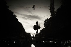 Precarious balance (Mi-Fo-to) Tags: street photography black white bianconero funambolo tightropewalker river fiume sera evening precarious balance person rope corda equilibrio