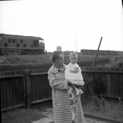 Nna and grandchild (vintage ladies) Tags: blackandwhite vintage people photograph 60s female woman lady 60slady 60swoman 60sstyle train child coat portrait