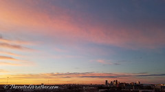 October 22, 2018 - Sunrise colors the clouds over downtown Denver. (ThorntonWeather.com)