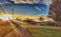 Sun rays sunrise!😊🌞 (LeanneHall3 :-)) Tags: sun sunrise sunrays sundaylights yellow white blue sky skyscape clouds talkativeclouds cloudsstormssunsetssunrises bridge green grass pathway walkway trees branches leaves lake eastpark hull kingstonuponhull landscape samsung groupenuagesetciel