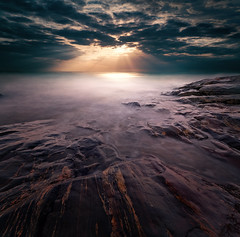 The Day It All Came Down. (Night and Mood photographs from Finland) Tags: finland clif rocks water mood mystical sun sky clouds emäsalo