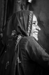Smile (Syahrel Azha Hashim) Tags: foodpreparation activity nikon expression bw 35mm holiday pc9 simple indian details portraiture india local hijab dof smile remotelocation prime isolated getaway handheld closeup moment vacation destination rajasthan light female naturallight traditionalclothing shallow portrait d300s travel syahrel woman sariska people blackwhite smiling humaninterest culture detail