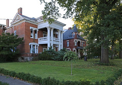 Houses — Lexington, Kentucky (Pythaglio) Tags: house dwelling residence historic classicalrevival ca1900 portico entablature dentils denticulate columns fluting fluted corinthian capitals brick twostory ornate lexington kentucky fayettecounty bushes trees shrubbery