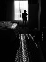 Morning (llabe) Tags: bw monotone blackandwhite hotel bedroom woman silhouette shadow nikon d750