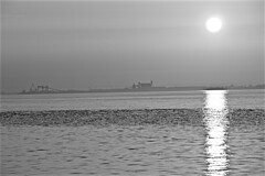 Sun Rise Hessle Foreshore  Monochrome (brianarchie65) Tags: riverhumber sunrise water sea sun seats bridge stone monochrome eastyorkshire yorkshirecameraramblers yorkshireblackandwhite blackandwhite blackandwhitephotos blackandwhitephoto blackandwhitephotography blackwhite123 blackwhiterealms flickrunofficial flickr flickruk flickrcentral flickrinternational ukflickr canoneos600d geotagged brianarchie65 unlimitedphotos ngc sky trees