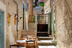 Al Fresco, Nafplio (RCARCARCA) Tags: lights alley tables steps treetrunk nafplio chairs eosr gates greece sunlight canon 24105l autumn door