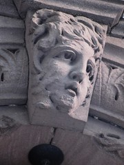 Wind Blown Gargoyle Face Above Doorway 4808 (Brechtbug) Tags: gargoyle face above doorway building facade 25th street between 7th 8th avenues brownstone entrance nyc 11122018 new york city midtown manhattan 2018 gargoyles portraits monster portrait monsters creature faces spooky art architecture sculpture keystone mask brownstones brown stone