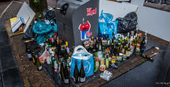 2018 - Amsterdam - Waiting For Pick Up (Ted's photos - For Me & You) Tags: 2018 amsterdam cropped nikon nikond750 nikonfx tedmcgrath tedsphotos vignetting bottles garbage streetscene street emptybottles red redrule