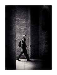 Into Shadows (Dave Fieldhouse Photography) Tags: streetphotography street pavement archway brick london capital city citycentre urban youth hoodie mono blackandwhite monochrome shadows lightandshade portrait fuji fujixpro2 fujinon35mmf2 wwwdavefieldhousephotographycom