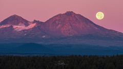 Moonset at Sunrise (TierraCosmos) Tags: bend sunrise moon moonset settingmoon fullmoon morning alpenglow mountains threesistersmountains northsister middlesister cascaderange landscape forest centraloregon oregon