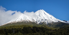 Mount Taranaki and Fantham Peak (loveexploring) Tags: egmontnationalpark fanthampeak mountegmont mounttaranaki newzealand northisland taranaki bluesky bush cloud forest landscape mountain panorama sky snow stratovolcano volcano
