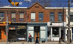 Queen Street East, Leslieville, Toronto. (edk7) Tags: nikond300 sigma2470mm128dghsmex edk7 2011 canada ontario toronto leslieville queenstreeteast person people male female dogwalker dog shop store storefront window sidewalk signage sign utilitypole 19thccommercialrow architecture building oldstructure city cityscape urban