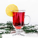 Christmas background with mulled wine and snow-covered Christmas tree branches