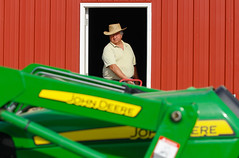 Buitrago walks toward his tractor at the farm.