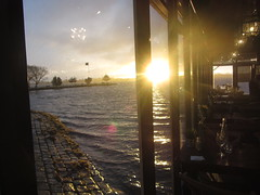 Going, going ..... sunset from the Boatshed, Lake Wendouree, Ballarat (d.kevan) Tags: theboatshed bars restaurants chairs tables windows views sunsets terraces lakewendouree ballarat victoria lakes flagstaffs flags plants glasses bottles condiments light