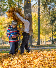 Kids Playing in Autumn Park (AudioClassic) Tags: autumn fall child happy park nature girl fun people season kid cute beautiful yellow person young joy outdoor smile caucasian playful leaves portrait childhood orange foliage happiness colorful little outside leaf laughing positive family maple forest seasonal small boy day playing golden lifestyle pleasure fashion tree october two face outdoors active friends leisure kids together jumping