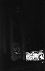 Nightly prayers (stevenguz) Tags: film 35mm 35mmfilm epsonv600 analog canonet contrast canonetql17giii 40mm church bw blackandwhite blackwhite pray sign highlights shadows streetphotography sanpedro street photography japanesecamerahunter jchstreetpan 400iso jchstreetpan400