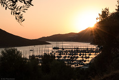 As boats rest (Anthony P.26) Tags: boat category kas landscape places seascape sunset transport travel turkey canon1585mm canon70d canon landscapephotography travelphotography sun sunstar sunrays silhouette bay water sea inlet hills sky rest boats harbour marina naturalharbour outdoor trees