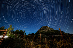 Non si può rinchiudere il cielo (fiore_lla4ever) Tags: star trail sky night la mia stella sei tu full moon landscape castle rock lightroom canon eos 6d samyang 14mm flower pixoom