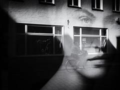 The Face (Sandy...J) Tags: olympus reflection street streetphotography sw urban noir light darkness blackwhite bw monochrom mono city biker photography window germany spiegelung absoluteblackandwhite