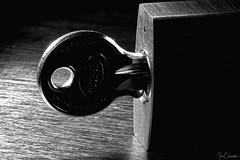 Under Lock and Key (Ian Charleton) Tags: macromondays perfectmatch blackandwhite lock key lowkey backlit wood monochrome