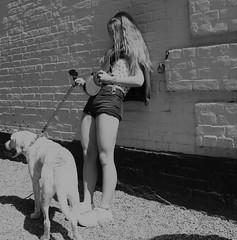 Dog Walking (Bury Gardener) Tags: suffolk streetphotography street snaps streetcandids strangers southwold seaside candid candids people peoplewatching folks england eastanglia uk bw blackandwhite monochrome mono