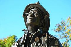 Fire Service Memorial in Miller Park -- Bloomington, Illinois (forestforthetress) Tags: millerpark bloomington firefighter fireman fireservicememorial color outdoor nikon omot man face state hero brave memorial