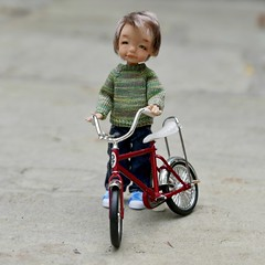 Charlie (Jay Bird Finnigan) Tags: bjd nikitka miniature 112 knitting thread doll sweater bike bicycle hallmark