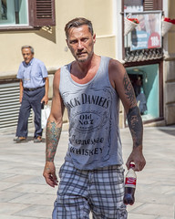 little and large (areavie@gmail.com) Tags: mahon menorca jack daniels tattoo arm tattoos male street photography canon 5d candid